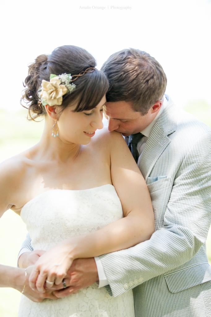 bride and groom kissing shoulder