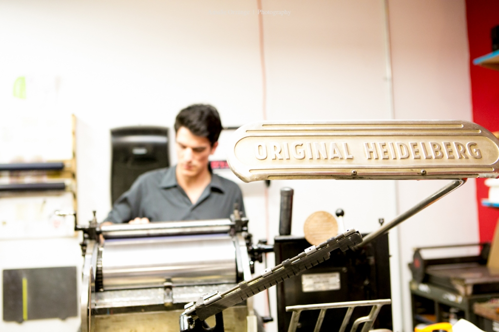 guy operating letter press