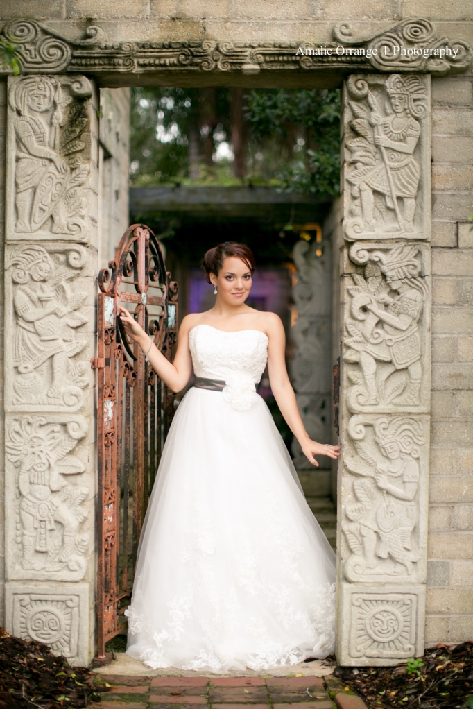 Bride leaning on gate winter park florida