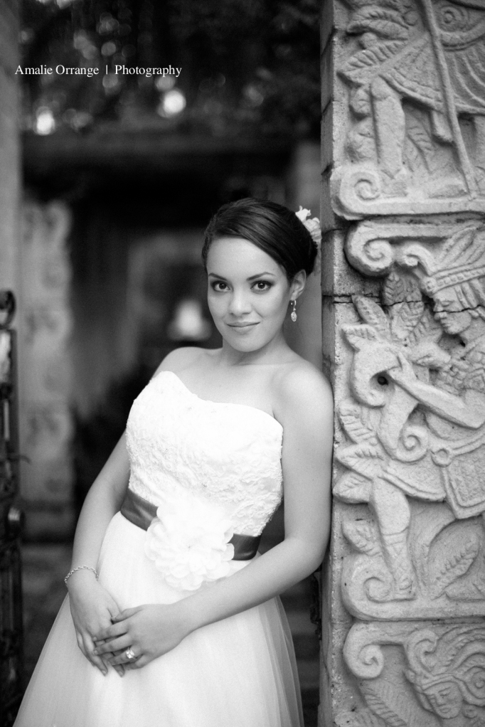 Bride leaning on wall