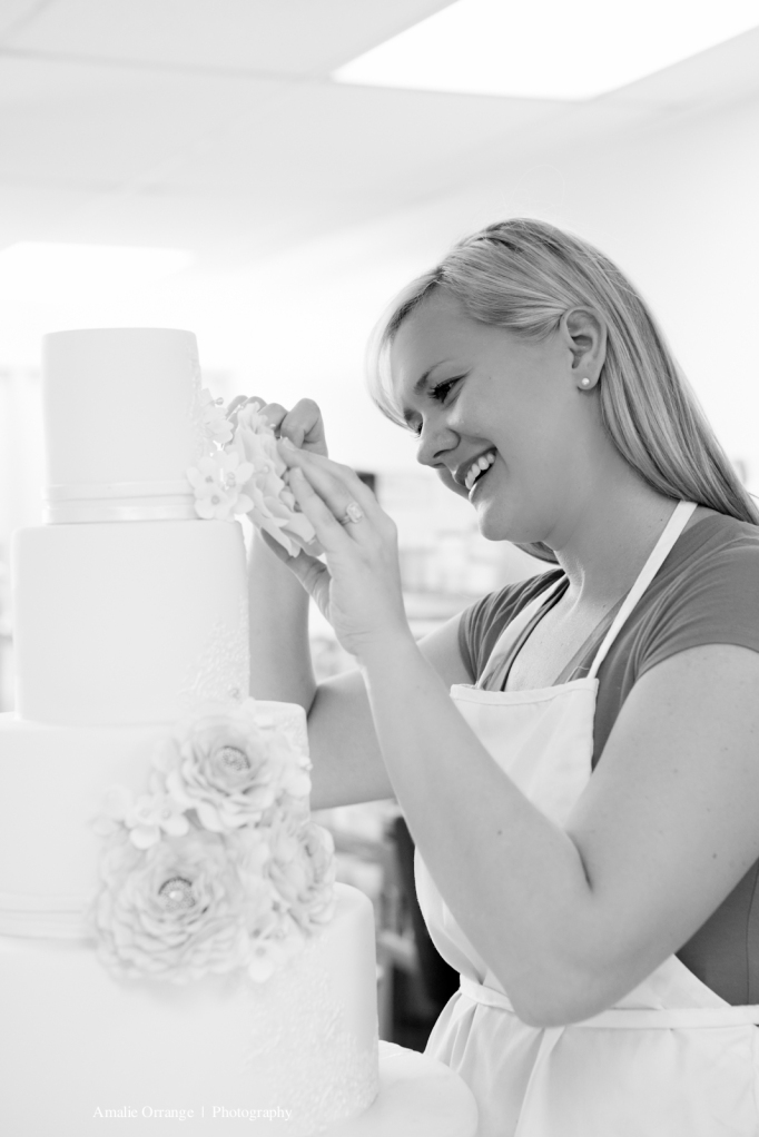 Girl decorating wedding cake