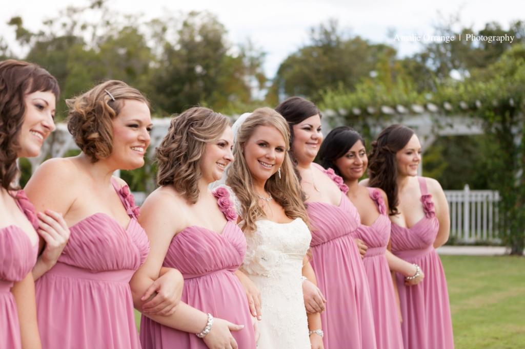 Bride looking a  camera with bridesmaids