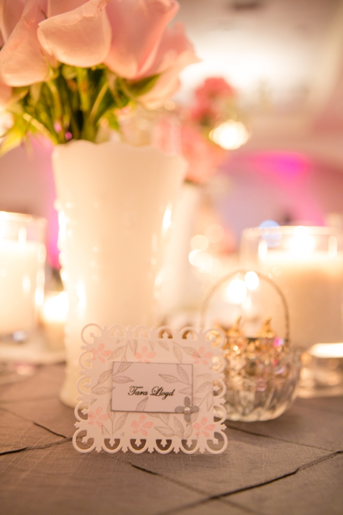 Table setting with candle and pink decor