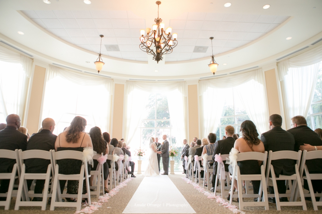 Wide angle of bride and groom at alter