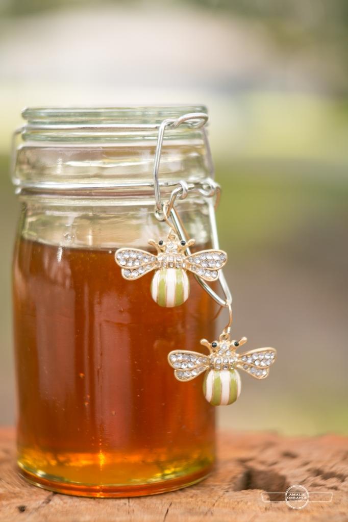 jar of honey with bee earrings
