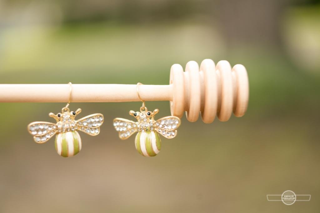 Bee earrings for wedding on honey stirrer