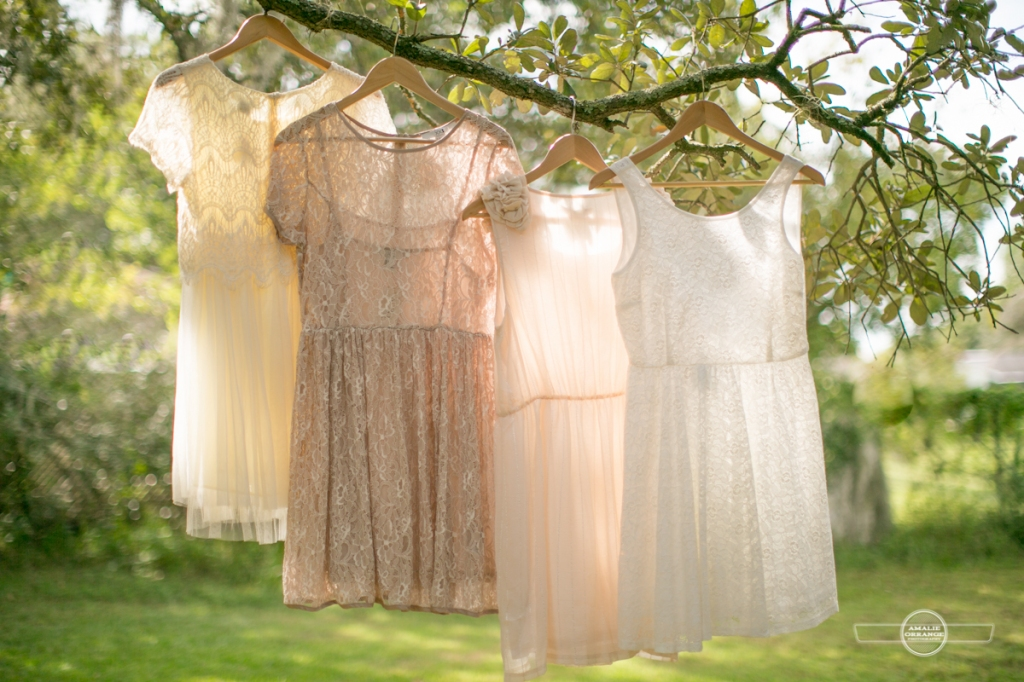Wedding dresses hanging on tree branch