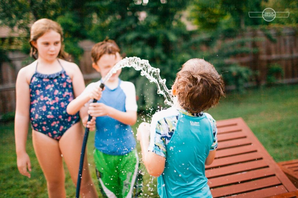 kids in sprinkler