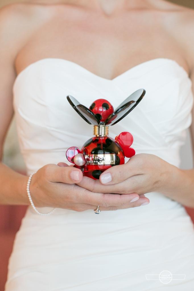 Florida beach wedding  bride holding perfume