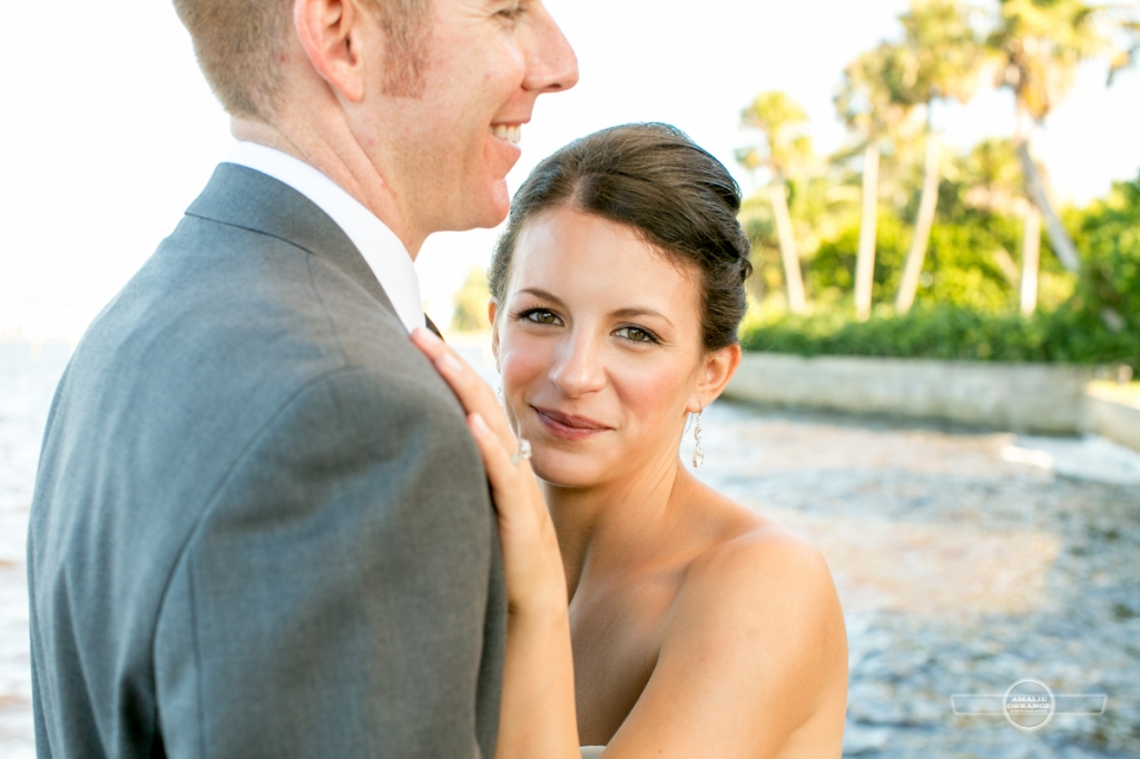 Bride hugging groom beach wedding