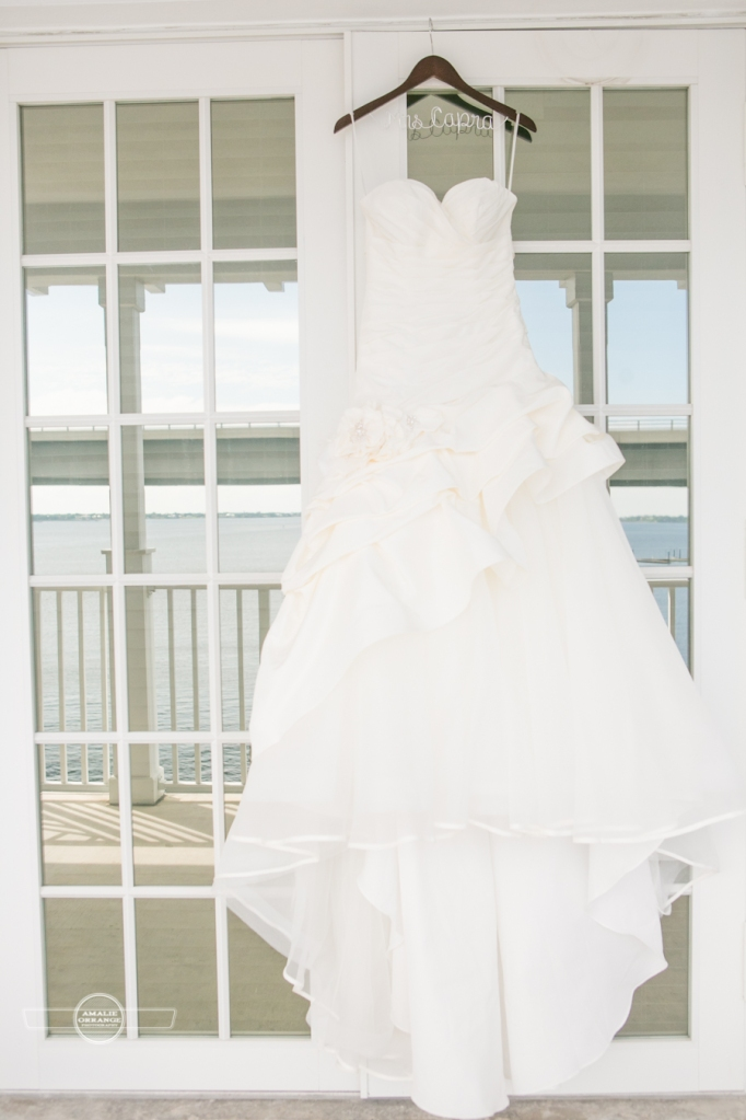 Florida beach wedding brides gown hanging