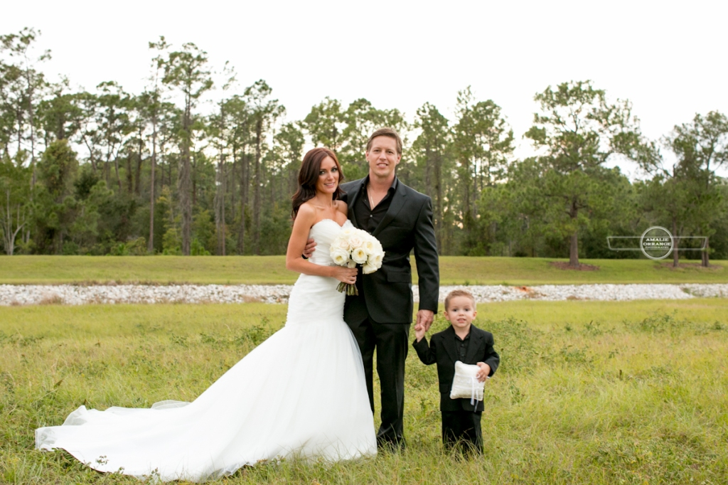 Bride and groom with child