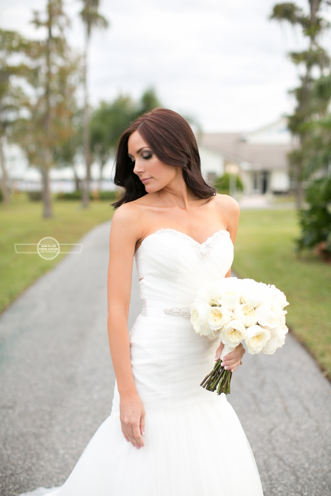 Bride with flowers looking over shoulder