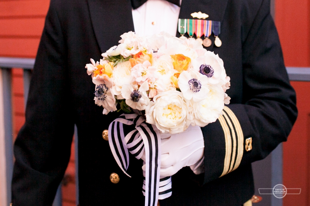 military groom holding bouquet