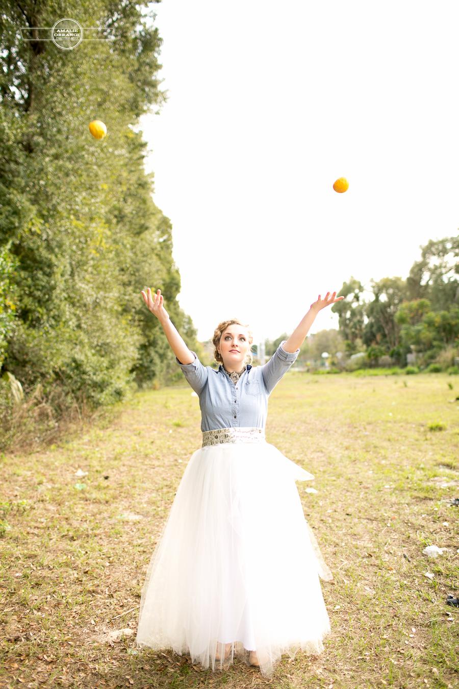 girl throwing lemons