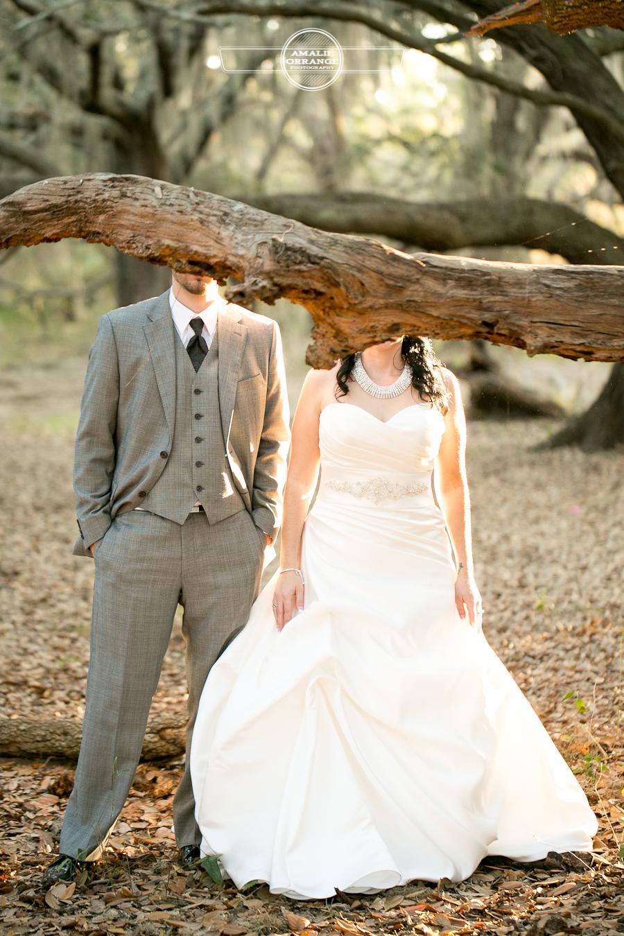 bride and groom behind tree